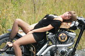 Attractive model on a custombike — Stock Photo