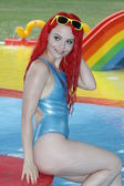 Swimsuit model in a water fun park — Stock Photo