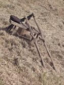 Old scythe on hay — Stockfoto
