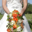 Stock Photo: Orange Bridal bouquet of roses