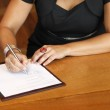 Bride signing marriage contract — Stock Photo