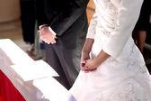 Bride and groom prays — Stock Photo