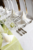 Served table in green and white — Stock Photo