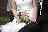 Sitting bride and groom — Stock Photo