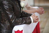 Praying bride and groom — Stock Photo