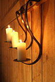 Burning candles as wall decoration — Stock Photo
