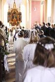 Communion children move into church — Stock Photo