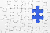Missing puzzle piece in blue — Stockfoto