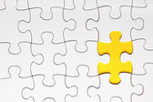 Missing puzzle piece in yellow — Stockfoto