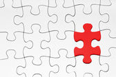 Missing puzzle piece in red — Stockfoto