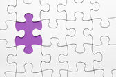 Missing puzzle piece in purple — Stock fotografie