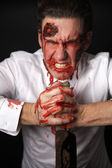 Psychopath with bloody knive — Stockfoto