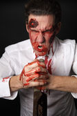 Psychopath with bloody knive — Stock Photo