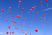 Balloon hearts in the sky — Stock Photo