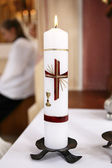 Burning candle in church — Stock Photo