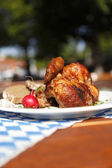 Half chicken in a traditional beer garden — Stock Photo