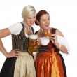Two bavarian girls with beer in traditional costumes — Stock Photo #46597893