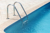 Swimming pool in the sun — Stock Photo