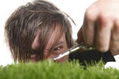 Young man cuts English lawn  — Stock Photo