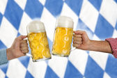 Cheers at the Oktoberfest — Stock Photo