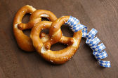 Two typical bavarian pretzel with white and blue streamer — Stock Photo