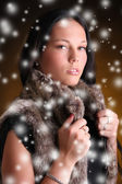 Beautiful model in winter fur waistcoat — Stock Photo