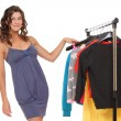 Stock Photo: Young female choosing clothes
