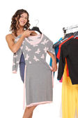 Young woman trying to pick clothes — Stock Photo