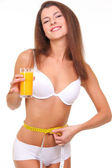Beautiful sporty woman with measure and glass of orange juice — Stock Photo