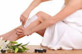 Removing hair from woman leg — Stock Photo