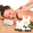 Young woman relaxing beeing massaged in spa saloon — Stock Photo #40604913