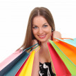 Portrait of young woman with shopping bags against white background — Stock Photo #40607287