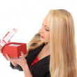 Beautiful girl with a gift box in hand — Stock Photo #40609917
