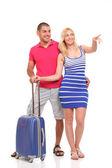Gelukkig jonge vrouw en een man met een koffer voor reizen — Stockfoto