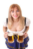 Smiling waitress with two mugs of beer — Stock Photo