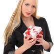 Beautiful girl with a gift box in hand — Stock Photo