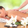 Beautiful woman enjoying a massage therapy — Stock Photo