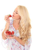 Beautiful young blond woman with strawberry — Stock Photo
