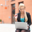 Business woman with laptop working outdoor — Stock Photo
