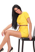 Young sexy girl in a yellow dress — Stock Photo