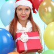 Stock Photo: Beautiful girl holding gifts