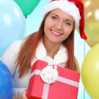 Beautiful girl holding gifts — Stock Photo