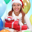 Beautiful girl in a white sweater holding gifts — Stock Photo #40813509