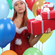 Beautiful young woman in Santa Claus clothes — Stock Photo #40813847