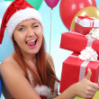 Surprised and happy girl with gifts — Stock Photo #40813851