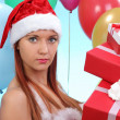 Beautiful girl dressed as Santa with gifts — Stock Photo #40813855