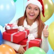 Pretty teenage girl with gifts in their hands — Stockfoto