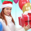 Pretty teenage girl with gifts in their hands — ストック写真