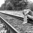 Upset girl sitting on rails — Stock Photo #40818431