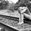 Upset girl sitting on rails — Stock Photo #40818435